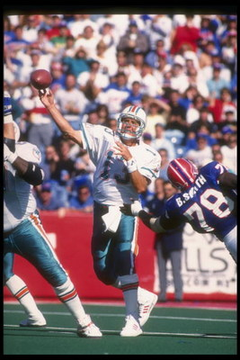 4 Oct 1992:  Quarterback Dan Marino of the Miami Dolphins passes the ball during a game against the Buffalo Bills at Rich Stadium in Orchard Park, New York.  The Dolphins won the game, 37-10. Mandatory Credit: Rick Stewart  /Allsport