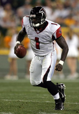GREEN BAY, WI - AUGUST 19:  Quaterback D.J. Shockley #1 of the Atlanta Falcons scrambles with the ball during the preseason game against the Green Bay Packers on August 19, 2006 at Lambeau Field in Green Bay, Wisconsin. The Packers won 38-10. (Photo by Jo
