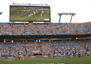 MIAMI, FL - JANUARY 4:  A large scoreboard shows play as the Miami Dolphins host the Baltimore Ravens in an NFL Wildcard Playoff Game at Dolphins Stadium on January 4, 2009 in Miami, Florida.  (Photo by Al Messerschmidt/Getty Images)