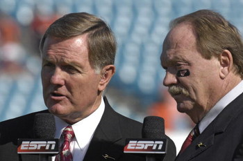 JACKSONVILLE, FL - DECEMBER 1: ESPN commentators Bob Griese (left) and Paul Maguire report from the sidelines as the Boston College Eagles battle the Virginia Tech Hokies in the ACC Championship Game at Jacksonville Municipal Stadium on December 1, 2007 i