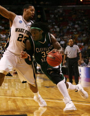 MIAMI - MARCH 20:  Forward J'Nathan Bullock #35 (R) of the Cleveland State University Vikings drives to the basket past forward James Johnson #23 (L) of Wake Forest Demon Deacons during the first round of the NCAA Division I Men's Basketball Tournament at