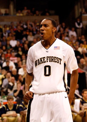 WINSTON-SALEM, NC - FEBRUARY 18:  Jeff Teague #0 of the Wake Forest Demon Deacons reacts to scoring a basket against the Georgia Tech Yellow Jackets during their game at Lawrence Joel Coliseum on February 18, 2009 in Winston-Salem, North Carolina.  (Photo