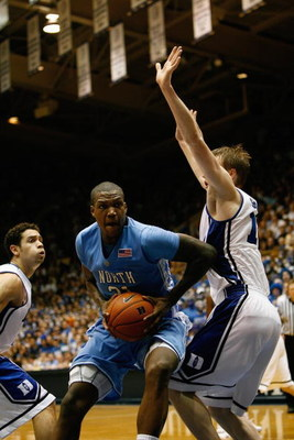 DURHAM, NC - FEBRUARY 11:  Deon Thompson #21 of the North Carolina Tar Heels moves to the basket against Kyle Singler #12 of the Duke Blue Devils during the game on February 11, 2009 at Cameron Indoor Stadium in Durham, North Carolina.  (Photo by Kevin C.