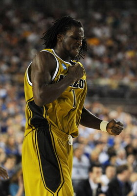GLENDALE, AZ - MARCH 26:  Forward DeMarre Carroll #1 of the Missouri Tigers celebrates after a play against the Memphis Tigers in the Sweet 16 of the NCAA Division I Men's Basketball Tournament at the University of Phoenix Stadium on March 26, 2009 in Gle