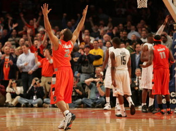 NEW YORK - MARCH 12: Justin Thomas #2 of the Syracuse Orange celebrates late in the sixth overtime against the Connecticut Huskies during the quarterfinal round of the Big East Tournament at Madison Square Garden on March 12, 2009 in New York City.  (Phot