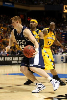 BOISE, ID - MARCH 20:  Forward Gary Wilkinson #55 of the Utah State Aggies drives with the ball against the Marquette Golden Eagles during the first round of the NCAA Division I Men's Basketball Tournament at the Taco Bell Arena on March 20, 2009 in Boise