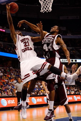 TAMPA, FL - MARCH 13:  Dominique Archie #21 of the South Carolina Gamecocks makes a shot over Brian Johnson #44 of the Mississippi State Bulldogs during the quaterfinal round of the SEC Men's Basketball Tournament on March 13, 2009 at The St. Pete Times F