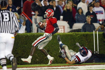 ATHENS, GA - NOVEMBER 9:  Terrence Edwards #8 of Georgia scores a touchdown as Wes Scott #17 of Mississippi defends during the SEC game on November 9, 2002  at Sanford Stadium in Athens, Georgia. The Bulldogs won 31-17. (Photo by Jamie Squire/Getty Images