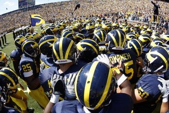 ANN ARBOR, MI - SEPTEMBER 6:  The Michigan Wolverines huddle together in a huddle prior to the game against the Miami of Ohio Red Hawks on September 6, 2008 at Michigan Stadium in Ann Arbor, Michigan.  The Wolverines defeated the Red Hawks 16-6. (Photo by