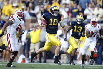 ANN ARBOR, MI - SEPTEMBER 27: Steven Threet #10 of the Michigan Wolverines rushes for a 58 yard fourth quarter gain while being pursued by Jonathan Casillas #2 the Wisconsin Badgers on September 27, 2008 at Michigan Stadium in Ann Arbor, Michigan. (Photo