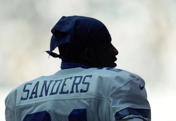 3 Oct 1999:  Deion Sanders #21 of the Dallas Cowboys looks on from the sidelines during the game against the Arizona Cardinals at the Texas Stadium in Dallas, Texas. The Cowboys defeated the Cardinals 35-7. Mandatory Credit: Matthew Stockman  /Allsport