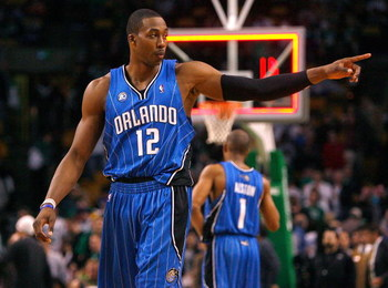 BOSTON, MA - MARCH 8:  Dwight Howard #12 of the Orlando Magic reacts in the final moments of a game against the Boston Celtics at the TD Banknorth Garden on March 8, 2009 in Boston, Massachusetts. The Celtics lost 86-79. NOTE TO USER: User expressly ackno