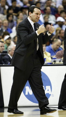 SAN ANTONIO - APRIL 3:  Head coach Mike Krzyzewski of the Duke Blue Devils gestures during the semifinal game of the NCAA Final Four Tournament against the UConn Huskies on April 3, 2004 at the Alamodome in San Antonio, Texas.  (Photo by Stephen Dunn/Gett
