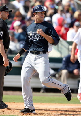 JUPITER, FL - MARCH 02:  Evan Longoria #3 of the Tampa Bay Rays scores a run against the St. Louis Cardinals during a spring training game at Roger Dean Stadium on March 2, 2009 in Jupiter, Florida. The Rays defeated the Cardinals 8-5.  (Photo by Doug Ben
