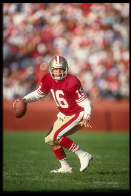 28 Oct 1990: Quarterback Joe Montana of the San Francisco 49ers looks down field for an open receiver as he drops back to pass during a play in the 49ers 20-17 victory over the Cleveland Browns at Candlestick Park in San Francisco, California.