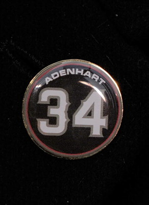 ANAHEIM, CA - APRIL 10:  A memorial pin with jersey number of pitcher Nick Adenhart of the Los Angeles Angels is seen on the jacket of his agent Scott Boras during the baseball game against the Boston Red Sox at Angel Stadium April 10, 2009 in Anaheim, Ca