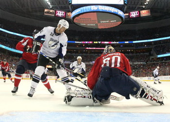 WASHINGTON - MARCH 27: Jose Theodore #60 of the Washington Capitals tends net against Ryan Malone #12 of the Tampa Bay Lightning on March 27, 2009 at the Verizon Center in Washington, D.C.  (Photo by Bruce Bennett/Getty Images)
