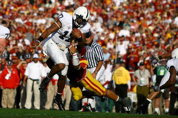 PASADENA, CA - JANUARY 01:  Quarterback Daryll Clark #17 of the Penn State Nittany Lions is dragged down by Taylor Mays #2 of the USC Trojans during the 95th Rose Bowl Game presented by Citi on January 1, 2009 at the Rose Bowl in Pasadena, California.  (P
