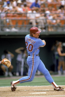 SAN DIEGO - 1986:  Third baseman Mike Schmidt #20 of the Philadelphia Phillies swings at the pitch during the 1986 season MLB game against the San Diego Padres at Jack Murphy Stadium in San Diego, California.  (Photo by Stephen Dunn/Getty Images)