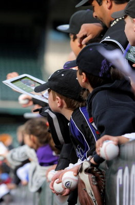 DENVER - APRIL 11:  Fans look to get autographs from the players as the Philadelphia Phillies face the Colorado Rockies during MLB action at Coors Field on April 11, 2009 in Denver, Colorado. The Phillies defeated the Rockies 8-4.  (Photo by Doug Pensinge
