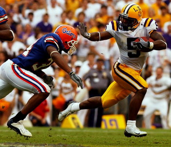 BATON ROUGE, LA - OCTOBER 11: Andre Caldewell of the Louisiana State University Tigers avoids a tackle from Daryl Dixon of the University of Florida Gators on October 11, 2003 at Tiger Stadium in Baton Rouge, Louisiana.  Florida would defeat LSU 19-7.  (P