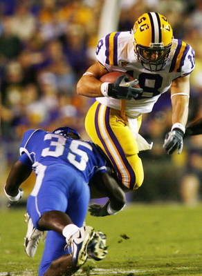 BATON ROUGE, LA - OCTOBER 14:  Jacob Hester #18 of Louisiana State University is tackled by Roger Williams #35 of Kentucky University on October 14, 2006 at Tiger Stadium in Baton Rouge, Louisiana.    (Photo by Chris Graythen/Getty Images)