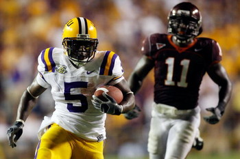 BATON ROUGE, LA - SEPTEMBER 08:  Keiland Williams # 5 of Louisiana State University runs past Xavier Adibi #11 of Virginia Tech on his way to scoring a touchdown on September 8, 2007 at Tiger Stadium in Baton Rouge, Louisiana. LSU defeated Virginia Tech 4