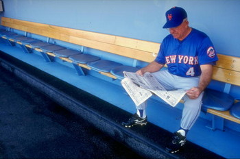 29 Aug 1998:  Coach Cookie Rojas #4 of the New York Mets reads a newspaper on the bench prior to a game against the Los Angeles Dodgers at Dodger Stadium in Los Angeles, California. The Mets defeated the Dodgers 4-3. Mandatory Credit: Donald Miralle  /All