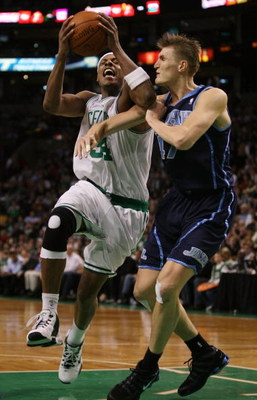 BOSTON - DECEMBER 15:  Paul Pierce #34 of the Boston Celtics is fouled by Andrei Kirilenko #47 of the Utah Jazz on December 15, 2008 at TD Banknorth Garden in Boston, Massachusetts. The Celtics defeated the Jazz 100-91. NOTE TO USER: User expressly acknow