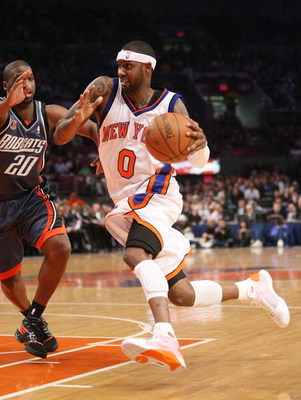 NEW YORK - MARCH 07:  Larry Hughes #0 of the New York Knicks drives to the basket against the Charlotte Bobcats on March 7, 2009 at Madison Square Garden in New York City. NOTE TO USER: User expressly acknowledges and agrees that, by downloading and or us