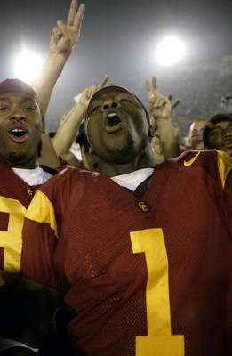LOS ANGELES - DECEMBER 6:  Wide receiver Mike Williams #1 of the USC Trojans celebrates with teammates following the game with the Oregon State Beavers on December 6, 2003 at the Los Angeles Coliseum in Los Angeles, California.  USC won 52-28.  (Photo by