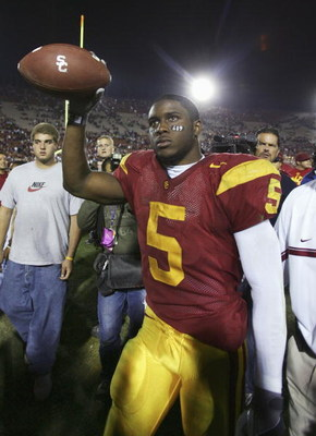 LOS ANGELES, CA - NOVEMBER 19:  Reggie Bush #5 of the USC Trojans celebrates after the game with the Fresno State Bulldogs at the Los Angeles Memorial Coliseum on November 19, 2005 in Los Angeles, California. The Trojans won 50-42. (Photo by Jeff Gross/Ge