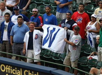 MILWAUKEE - JULY 31:  Fans of the Chicago Cubs hold up a win flag along the first baseline after the Cubs complete a four game sweep of the Milwaukee Brewers at Miller Park on July 31, 2008 in Milwaukee, Wisconsin. The Cubs defeated the Brewers 11-4.  (Ph
