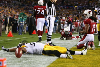 TAMPA, FL - FEBRUARY 01:  James Harrison #92 of the Pittsburgh Steelers reacts after scoring a touchdown on an 100 yards interception return in the second quarter as Larry Fitzgerald #11 of the Arizona Cardinals looks on during Super Bowl XLIII on Februar