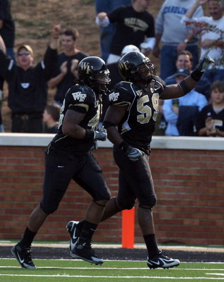 WINSTON SALEM, NC - OCTOBER 27:  Aaron Curry #59 of the Wake Forest Demon Deacons celebrates his touchdown against the UNC Tar Heels during the ACC game at the Groves Stadium on October 27, 2007 in Winston Salem,North Carolina.  (Photo by David Cannon/Get