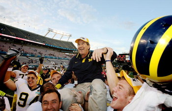 ORLANDO, FL - JANUARY 01:  Head coach Lloyd Carr of the Michigan Wolverines is carried off the field after ending his coaching career with a victory over the Florida Gators in the Capital One Bowl at Florida Citrus Bowl on January 1, 2008 in Orlando, Flor