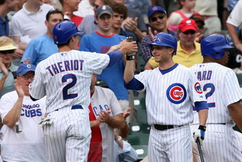 CHICAGO - JULY 19:  Ryan Theriot #2 and Mike Fontenot #17 of the Chicago Cubs celebrate after Theriot scored a run against the San Francisco Giants at Wrigley Field on July 19, 2007 in Chicago, Illinois. The Cubs won 9-8.  (Photo by Jamie Squire/Getty Ima