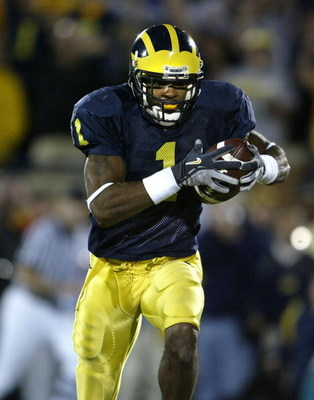 ANN ARBOR, MI - OCTOBER 30:  Wide Receiver Braylon Edwards #1 of the Michigan Wolverines catches a touchdown pass in the third overtime period against the Michigan State Spartans at Michigan Stadium on October 30, 2004 in Ann Arbor, Michigan. Michigan won