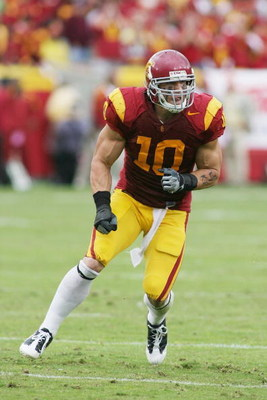 LOS ANGELES - NOVEMBER 1:  Brian Cushing #10 of the USC Trojans rushes against the Washington Huskies on November 1, 2008 at the Los Angeles Memorial Coliseum in Los Angeles, California.  USC won 56-0.  (Photo by Jeff Golden/Getty Images)