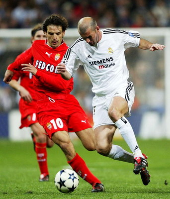MADRID, SPAIN - MARCH 24:  Zinedine Zidane of Real Madrid is tackled by Fernando Morientes of Monaco during the UEFA Champions League Quarter Final match between Real Madrid and Monaco at The Bernabeu on March 24, 2004 in Madrid, Spain.  (Photo by Clive M
