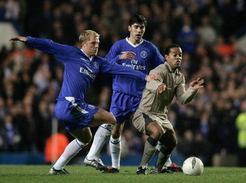 LONDON - MARCH 8: Eidur Gudjohnsen of Chelsea battles with Ronaldinho of Barcelona during the UEFA Champions League, First Knockout Round, Second Leg match between Chelsea and Barcelona at Stamford Bridge on March 8, 2005 in London, England.  (Photo by Be