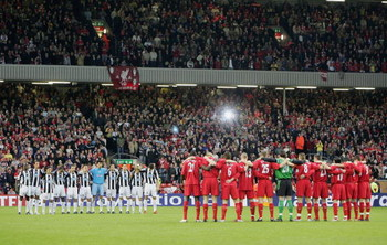 LIVERPOOL, UNITED KINGDOM - APRIL 5:  Juventus and Liverpool players stand with arms locked for one minutes silence commemorating the 20th anniversary of the Heysel Stadium disaster prior to the UEFA Champions League Quater-final, first leg match between