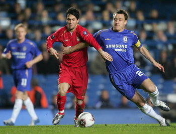 LONDON - DECEMBER 06:  John Terry of Chelsea battles with Luis Garcia of Liverpool during the UEFA Champions League Group G match between Chelsea and Liverpool at Stamford Bridge on December 6, 2005 in London, England.  (Photo by Jamie McDonald/Getty Imag