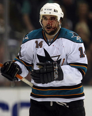 DALLAS - MAY 04:  Right wing Jonathan Cheechoo #14 of the San Jose Sharks skates to the bench after his face was cut against the Dallas Stars during game six of the Western Conference Semifinals of the 2008 NHL Stanley Cup Playoffs on May 4, 2008 at the A