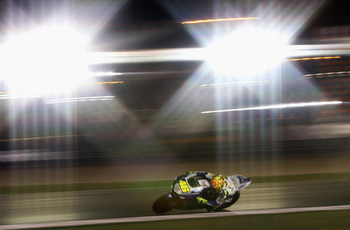 DOHA, QATAR - MARCH 09:  (EDITORS NOTE: A SPECIAL EFFECTS FILTER WAS USED IN THE CREATION OF THIS IMAGE) Valentino Rossi of Italy and the Fiat Yamaha Team in action during the Moto GP warm up for the Motorcycle Grand Prix of Qatar, round one of the MotoGP
