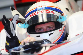 KUALA LUMPUR, MALAYSIA - MARCH 21:  Anthony Davidson of Great Britain and Super Aguri F1 prepares to drive while sitting in his car in team garage during practice for the Malaysian Formula One Grand Prix at the Sepang Circuit on March 21, 2008 in Kuala Lu