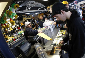 PITTSBURGH - APRIL 13:  Fans buy merchandise on opening day for the Pittsburgh Pirates prior to playing the Houston Astros at PNC Park April 13, 2009 in Pittsburgh, Pennsylvania.  (Photo by Gregory Shamus/Getty Images)