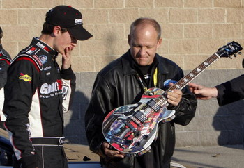 LEBANON, TN - APRIL 11:Joey Logano, driver of the #20 GameStop Toyota reacts as he see the winners trophy after winning the NASCAR Nationwide Series Pepsi 300 at the Nashville Superspeedway  on April 11, 2009 in Lebanon,Tennessee.   (Photo by John Sommers