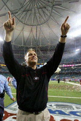 ATLANTA - DECEMBER 30:  Head coach Mark Richt of the Georgia Bulldogs celebrates after a 31-24 victory over the Virginia Tech Hokies during the Chick-fil-a Bowl on December 30, 2006 at the Georgia Dome in Atlanta, Georgia.  (Photo by Streeter Lecka/Getty