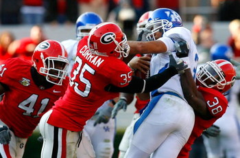 ATHENS, GA - NOVEMBER 17:  Quarterback Andre Woodson #3 of the Kentucky Wildcats is sacked by defenders Rennie Curran #35 and Marcus Howard #38 of the Georgia Bulldogs during the second half at Sanford Stadium on November 17, 2007 in Athens, Georgia.  Geo